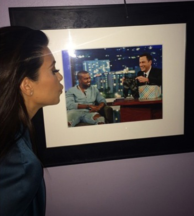 Kim Kardashian kisses a Kanye West picture at Jimmy Kimmel Live, 4 August 2014