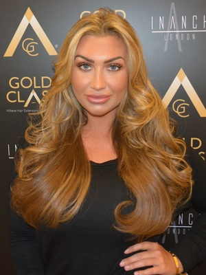 Lauren Goodger poses after having hair extensions applied at Inanch London - 11 August 2014