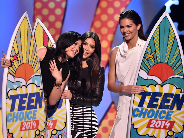 Kylie Jenner, Kim Kardashian, and Kendall Jenner onstage during FOX's 2014 Teen Choice Awards at The Shrine Auditorium on August 10, 2014 in Los Angeles, California. (Photo by Kevin Winter/Getty Images)