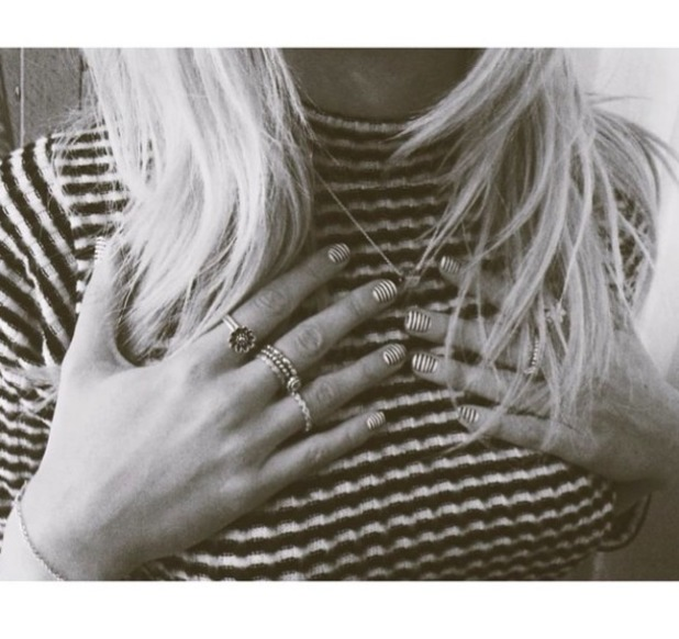 Pixie Lott matches her nails to her black and white, stripy top! 12 August 2014