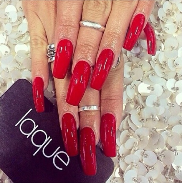 Vanessa Hudgens shows off her Christian Louboutin red manicure - 11 August 2014
