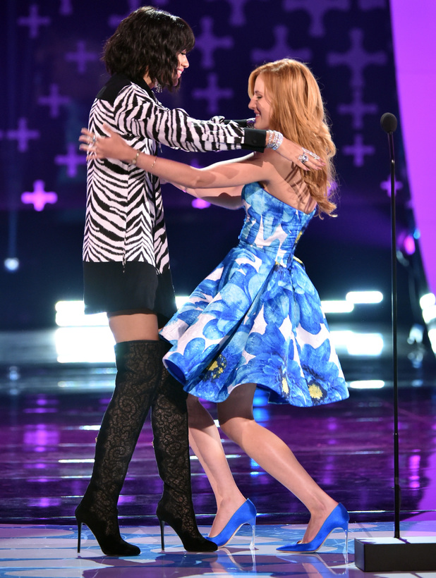 Bella Thorne presents an award to Zendaya at the Teen Choice Awards 2014 in Los Angeles, America - 10 August 2014