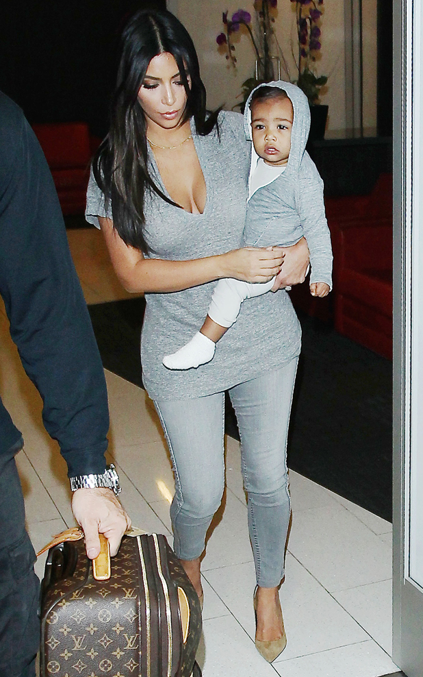 Kim Kardashian and daughter North West at the Los Angeles International Airport, America - 10 Aug 2014