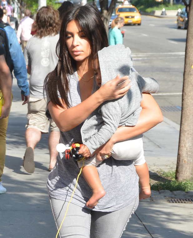 Kim Kardashian with daughter North West in New York, 11 August 2014