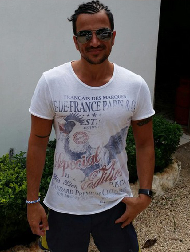 Peter Andre shows off his new hairdo while on holiday in Africa, 11 August 2014