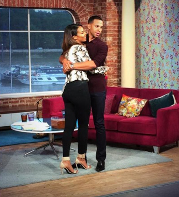 Rochelle steals a hug from husband Marvin Humes at This Morning, 15 August 2014