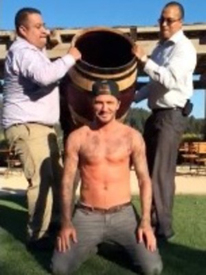 David and Brooklyn Beckham do the ice bucket challenge - 20 August 2014