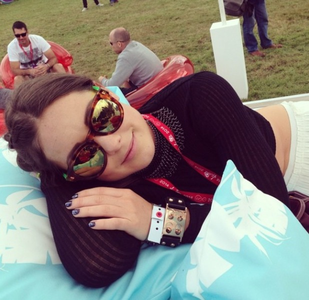Louise Thompson poses at V Festival's Louder Lounge, 18 August 2014