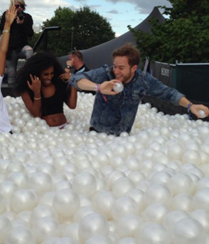Olly Murs and Alexandra Burke play in ball pit at Louder Lounge, V Festival, Hylands Park, Chelmsford, Essex, Britain - 17 Aug 2014