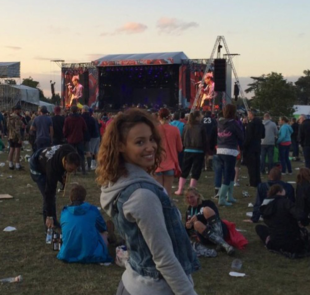Amelle Berrabah watches Paolo Nutini perform at V Festival, Hylands Park, Essex, 17 August 2014