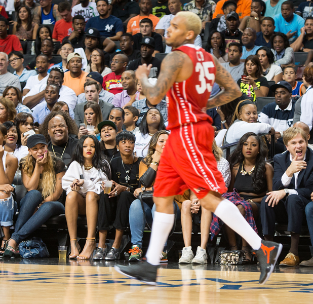 Rihanna watches Chris Brown playing in Summer Classic Charity Basketball Game held at the Barclay's Center, New York, 21 August 2014