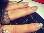 Copy Sarah Hyland's chic beige and gold striped Emmys manicure