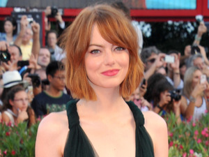 Emma Stone steals the show in plunging emerald green gown in Venice