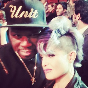 Kelly Osbourne poses for picture with 50 Cent on the set of the Chelsea Lately finale on E! (26 August).