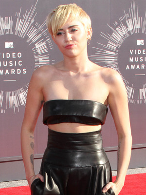 Miley Cyrus wears a leather outfit to the MTV Video Music Awards in Los Angeles, America - 24 August 2014