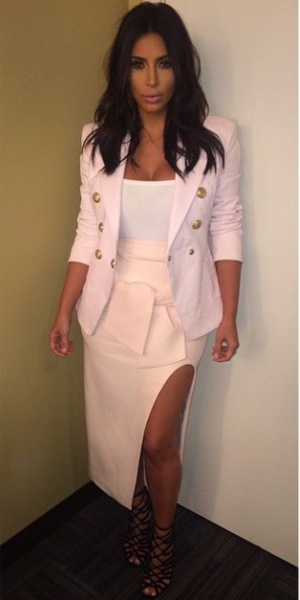 Kim Kardashian wears pale pink designer skirt for night out with friends - 28 Aug 2014
