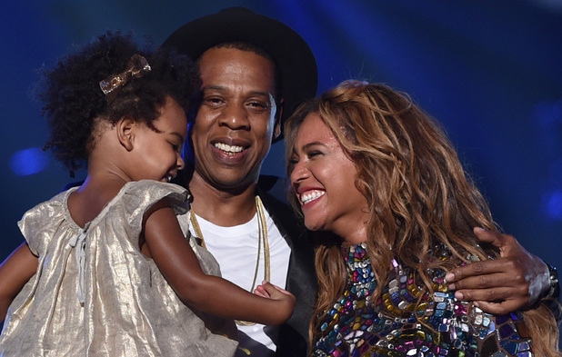 Blue Ivy Carter, recording artists Jay-Z and Beyonce speak onstage during the 2014 MTV Video Music Awards at The Forum on August 24, 2014 in Inglewood, California.