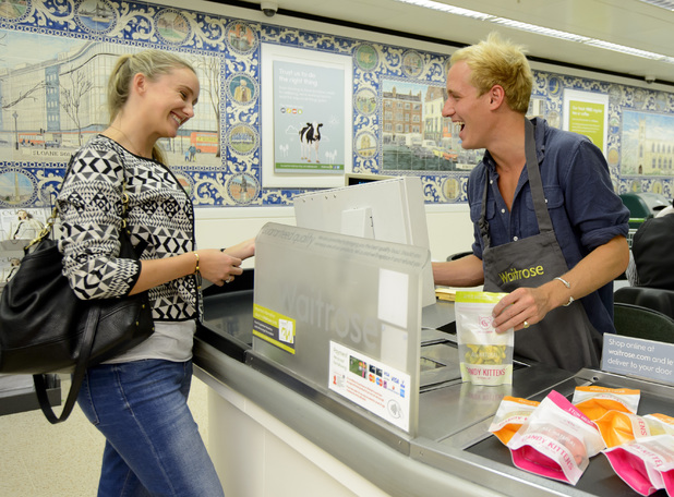 Jamie Laing working on the tills to promote his confectionary brand Candy Kittens, Waitrose, King's Road, London 29 August