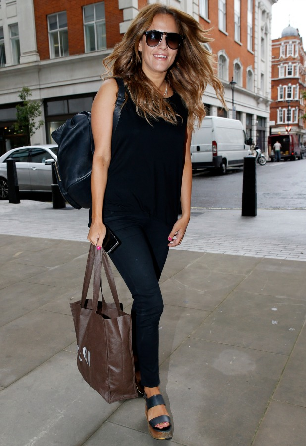 Caroline Flack seen arriving at the BBC Radio 1 Studios on August 28, 2014 in London, England. Photo by Alex Huckle/GC Images)