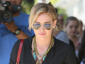 Hilary Duff rocks ripped jeans while shopping up a storm in LA