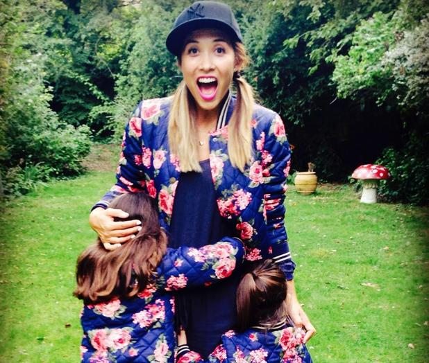 Myleene Klass models an adult size floral bomber jacket from her Baby K range with daughters Ava and Hero - 3 September 2014