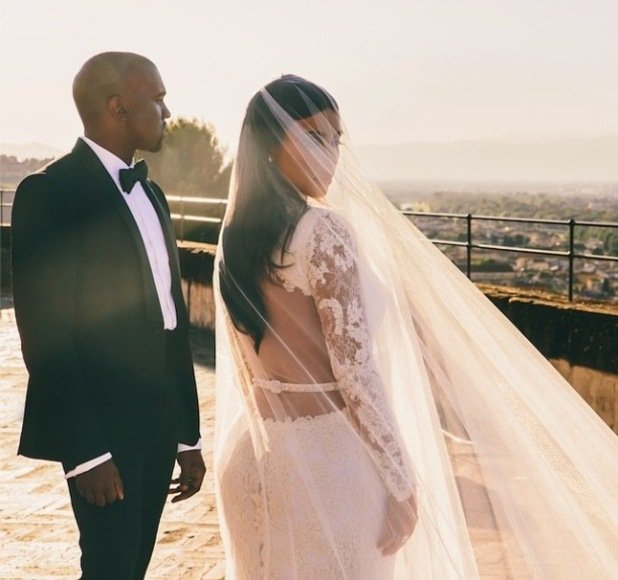 Kim Kardashian shares a new picture of herself and Kanye West on their wedding day - 2 September 2014