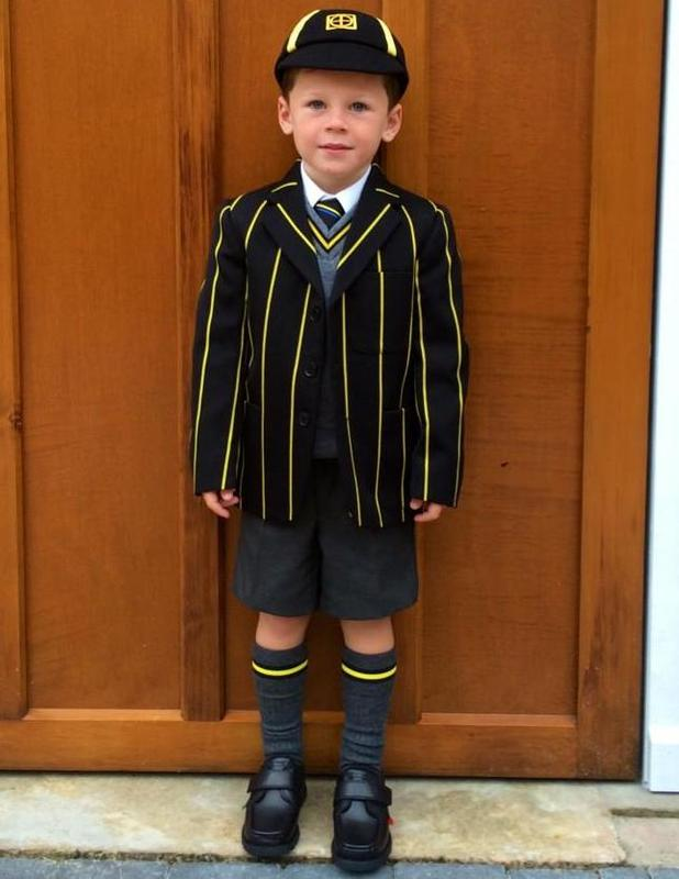 Coleen Rooney shares picture of Kai on his first day at school - 3 September 2014