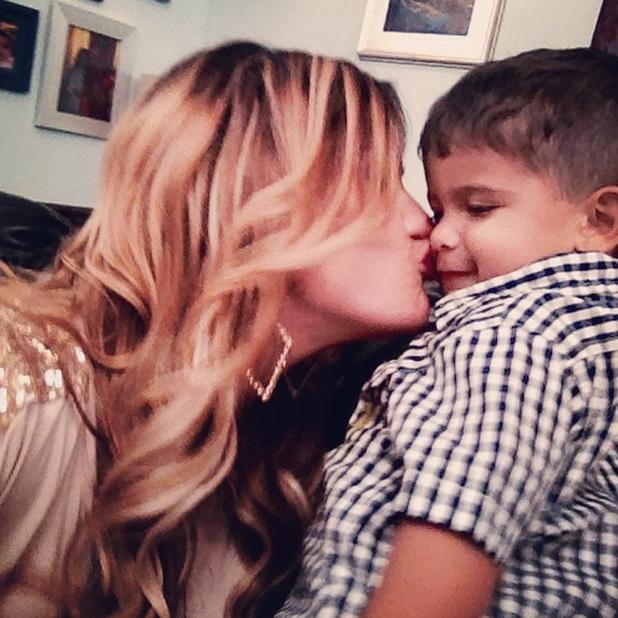 Jwoww plants a kiss on Snooki's son Lorenzo, August 2014