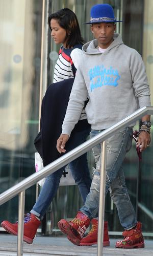 Pharrell Williams leaves his hotel in Manchester - 10 September 2014.