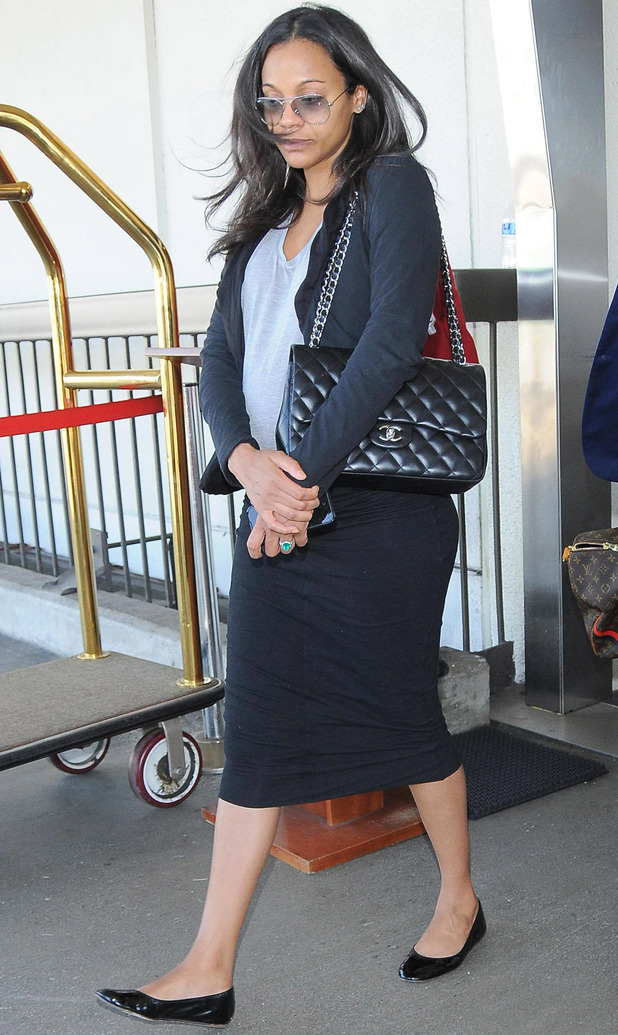 A pregnant Zoe Saldana at Los Angeles International Airport (LAX) - 11 September 2014