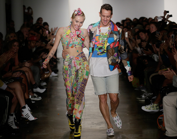 Miley Cyrus and Jeremy Scott walk the runway at Jeremy Scott during MADE Fashion Week Spring 2015 at Milk Studios on September 10, 2014 in New York City. (Photo by Randy Brooke/WireImage).
