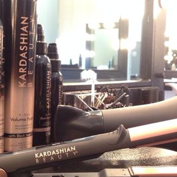Khloe Kardashian gives a sneak peek of the new Kardashian Beauty Hair range - 7 September 2014