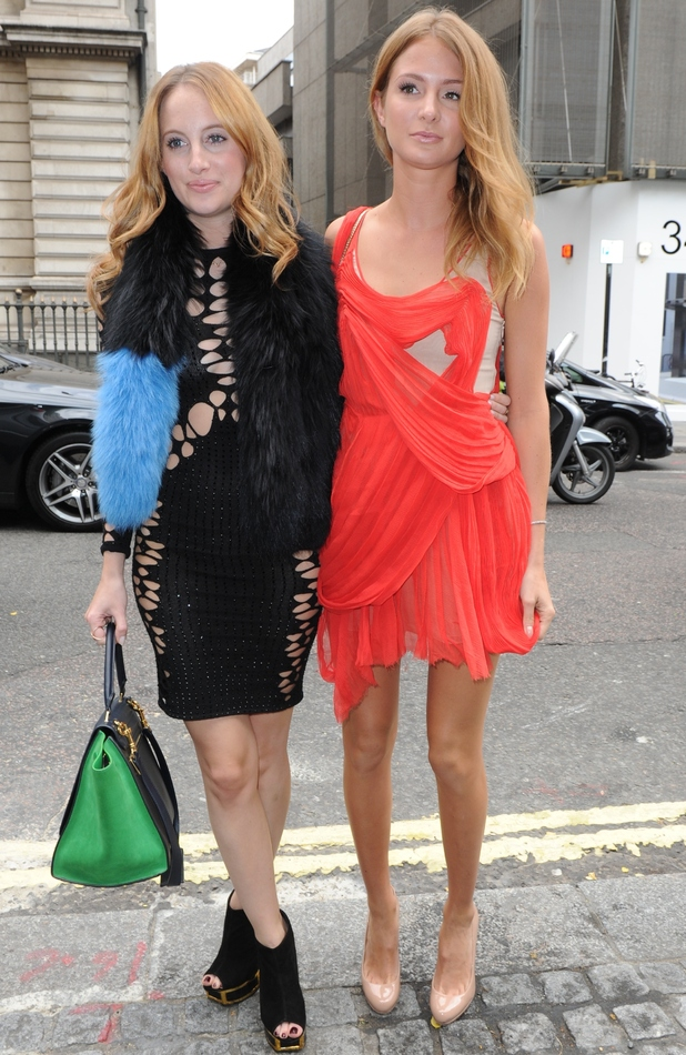 Rosie Fortescue and Millie Mackintosh attend Julien Macdonald's catwalk show at the Royal Opera House in London during LFW, 13 September 2014
