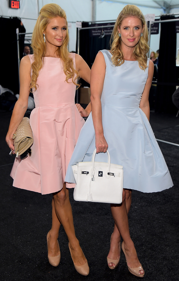 Paris Hilton and Nicky Hilton wear matching dresses at the Dennis Basso spring/summer '15 show during New York Fashion Week - America - 8 September 2014