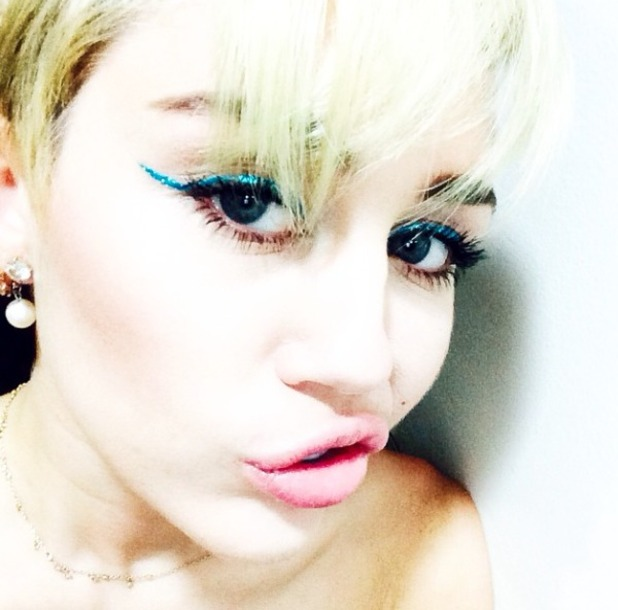 Miley Cyrus shows off turquoise, glitter eyeliner before performance in Monterey, Mexico, 17 September 2014