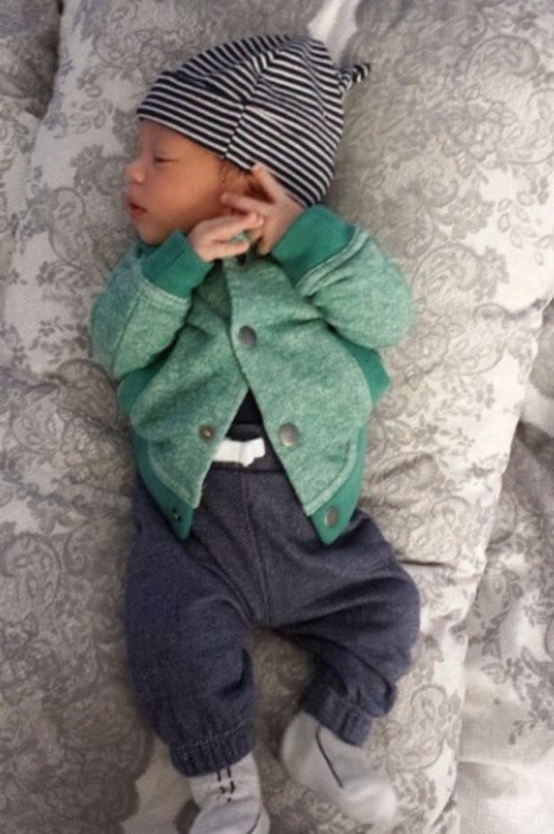 Oritsé Williams and Aimee Jade Azari have shared a new picture of their baby son Omré as he turns three weeks old - 13 September.