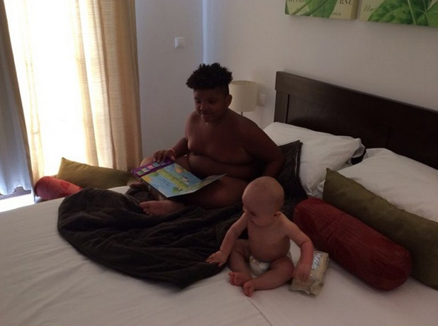 Katie Price's son Harvey reads a book to his little brother Jett, 18 September 2014