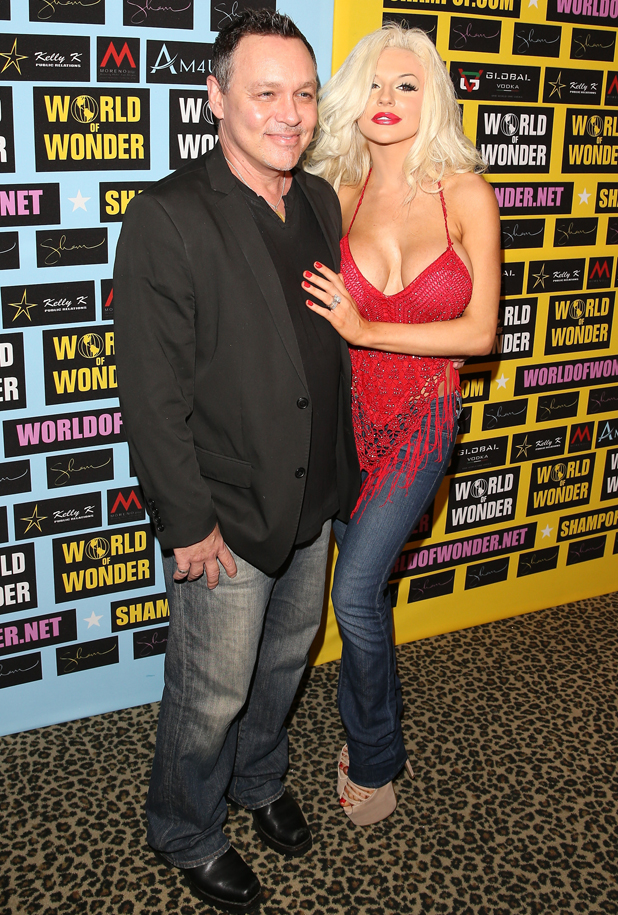 Doug Hutchison and Courtney Stodden attend a private art exhibition of Hollywood's favorite Pop Culture artist Sham Ibrahim on September 18, 2014, in Hollywood, California. (Photo by JB Lacroix/WireImage)