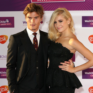 Oliver Cheshire and Pixie Lott attends the WellChild Awards at London Hilton on September 22, 2014 in London, England.