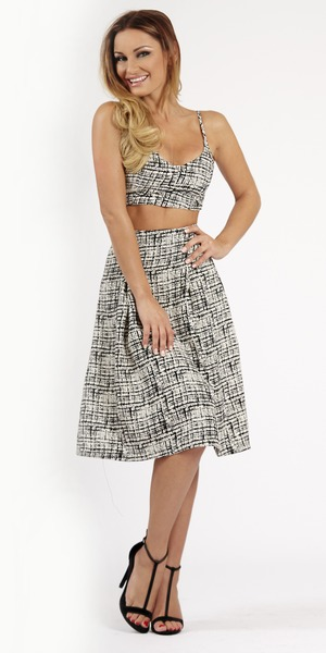Sam Faiers models a crop top and skirt in a photo for her Reveal fashion and beauty column