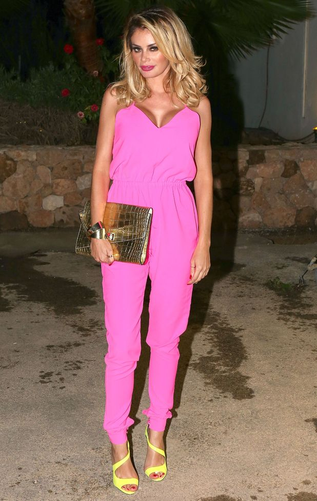 Chloe Sims wears a pink jumpsuit while out in Ibiza, Spain - 23 September 2014