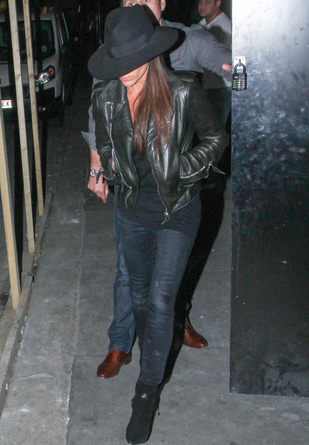 Victoria Beckham leaving her store on Dover Street wearing a large black hat, 22 September 2014