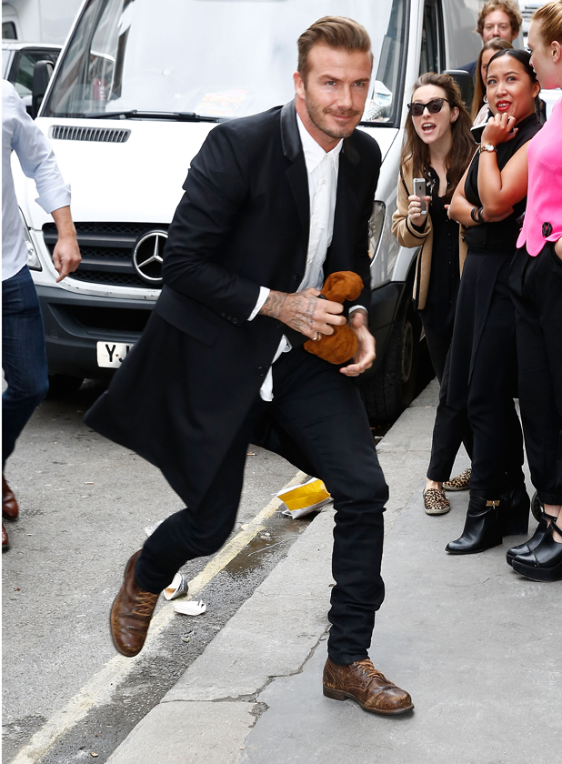 David Beckham arrives at Victoria Beckham's new flagship Dover Street store on September 25, 2014 in London, England. (Photo by Tim P. Whitby/Getty Images)