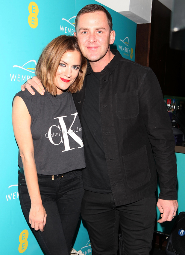 Caroline Flack and Scott Mills at Hilton London Wembley on September 23, 2014 in Wembley, England. EE transforms Wembley Arch with a spectacular light show to celebrate their partnership at an event last night.
