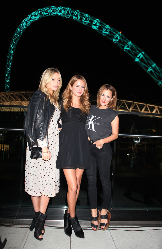Caroline Flack and Laura Whitmore and Millie Mackintosh at Hilton London Wembley on September 23, 2014 in Wembley, England. EE transforms Wembley Arch with a spectacular light show to celebrate their partnership at an event last night.