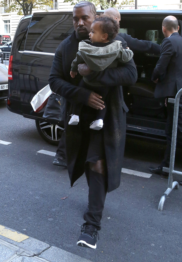 Kanye West and North West arrive at their apartment on September 24, 2014 in Paris, France.