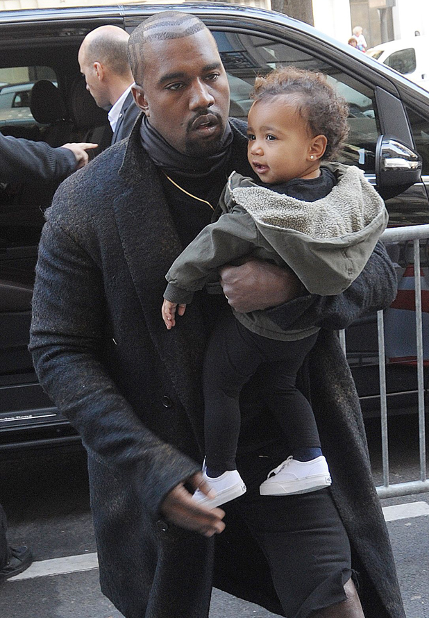 Kanye West carries baby North while out and about in Paris, France - 24 Sep 2014