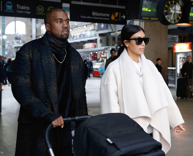 Kanye West, Kim Kardashian and North West arrive at 'Gare du Nord' station on September 24, 2014 in Paris, France. (Photo by Marc Piasecki/GC Images)