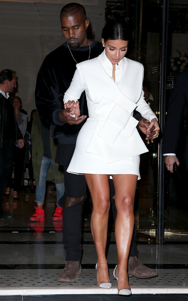 Kanye West and Kim Kardashian West leave the Buro 24/7 Fashion Forward Initiative cocktail event at the Peninsula Hotel on September 24, 2014 in Paris, France. (Photo by Pierre Suu/GC Images)