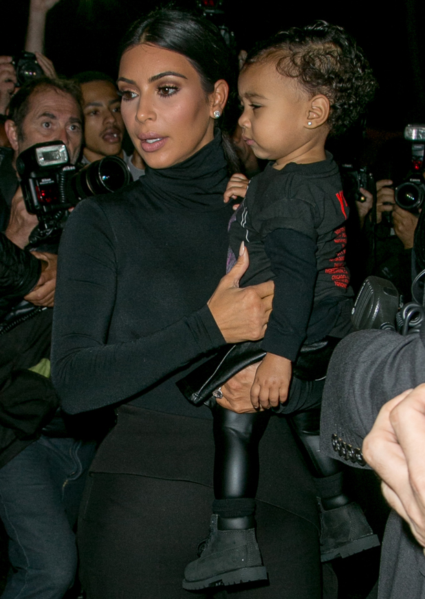 Kim Kardashian and North West arrive to attend the 'Balanciaga' ready-to-wear fashion show on September 24, 2014 in Paris, France.